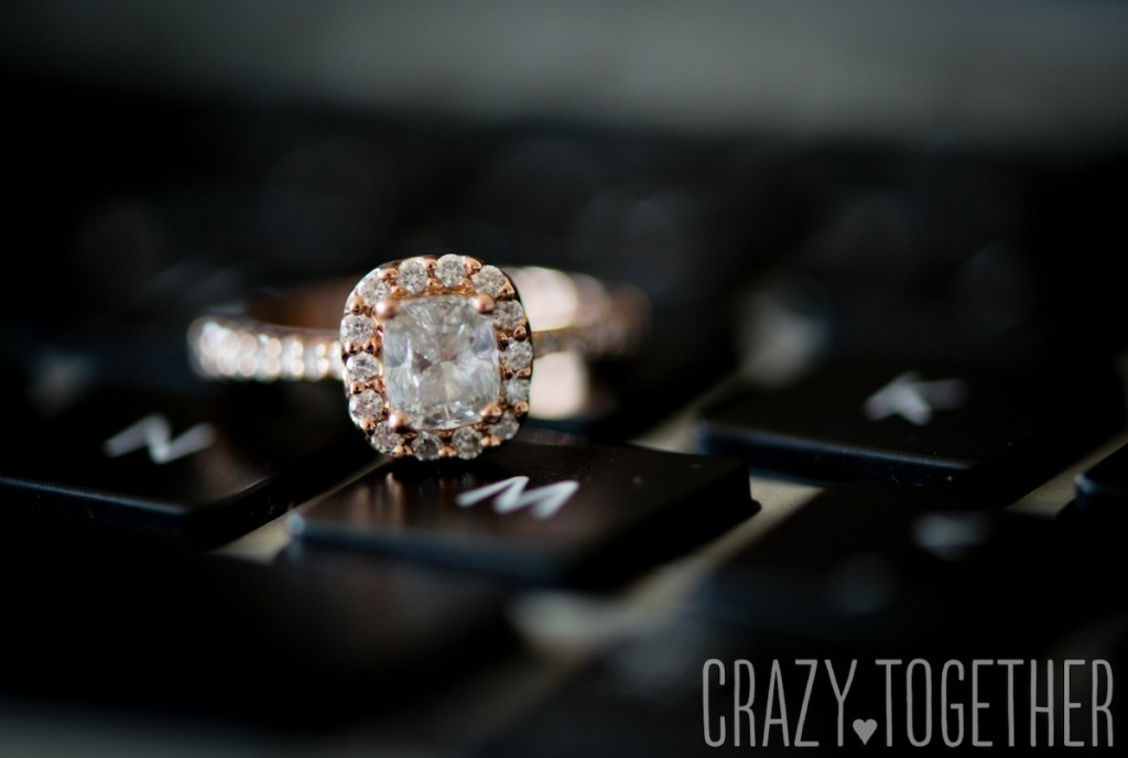diamond engagement ring on a macbook keyboard