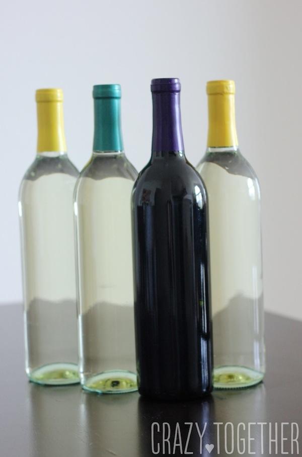 prepping wine bottles for custom gift labels