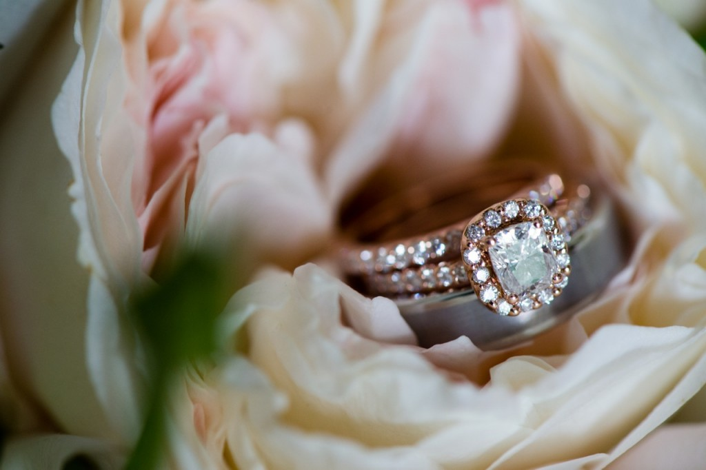 rose gold engagement ring with wedding bands tucked into a peony