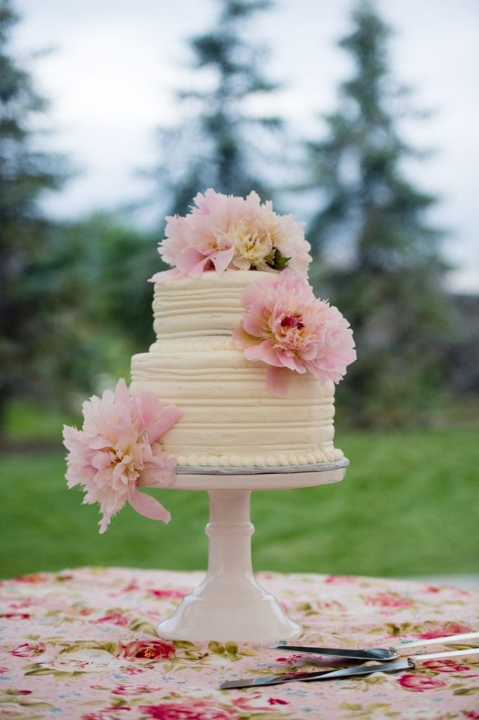 two-tier wedding cake with peonies