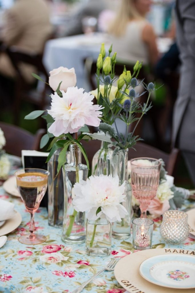 vintage wedding tabletop with antique salad plates, rose goblets, mercury glass, and birch vases