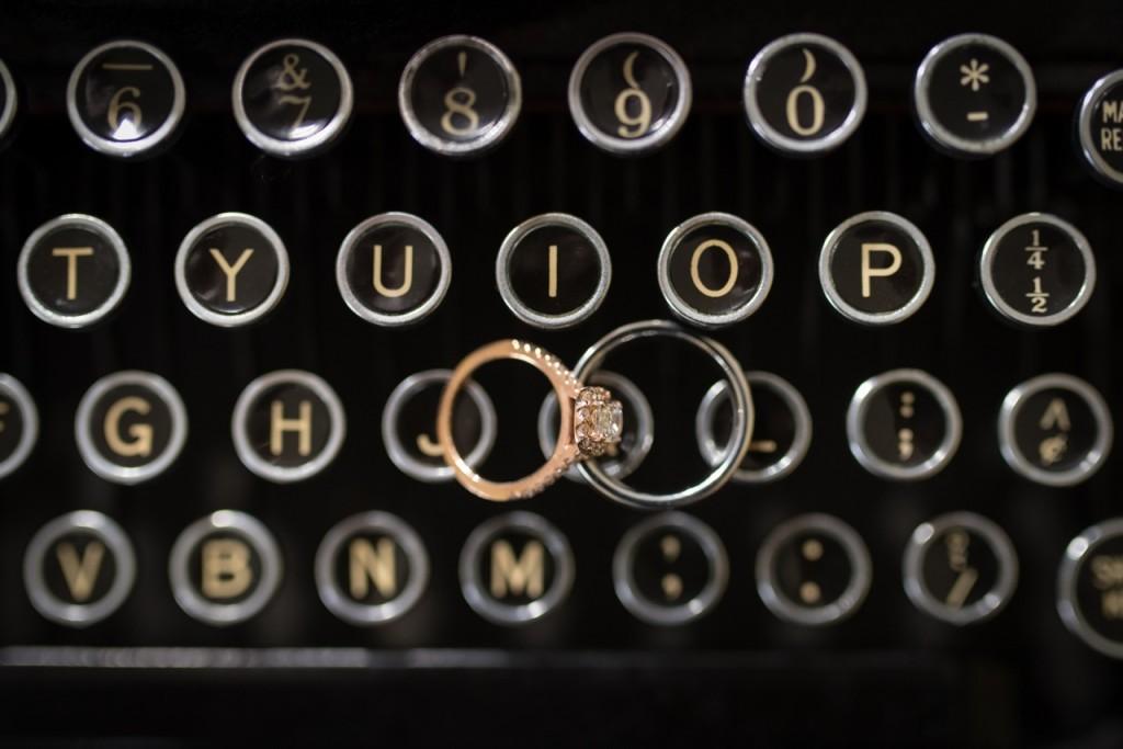 wedding rings on an antique typewriter - vintage wedding ideas