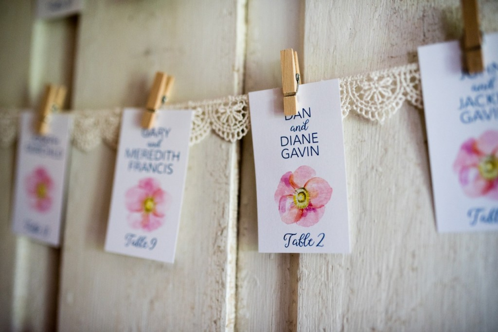 display escort cards on an old door - vintage wedding ideas