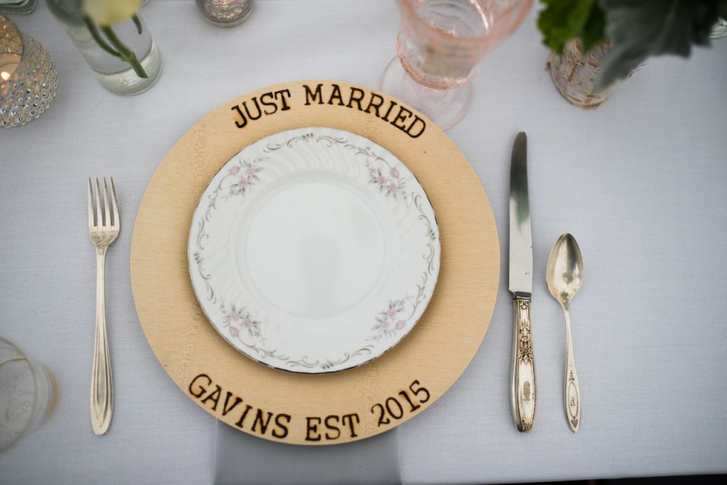 vintage wedding tableware with antique dishes, flatware and rose goblets. A personalized woodburned dinner plate is the perfect touch!