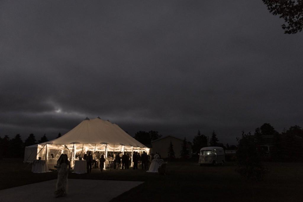 outdoor sailcloth tent wedding at night