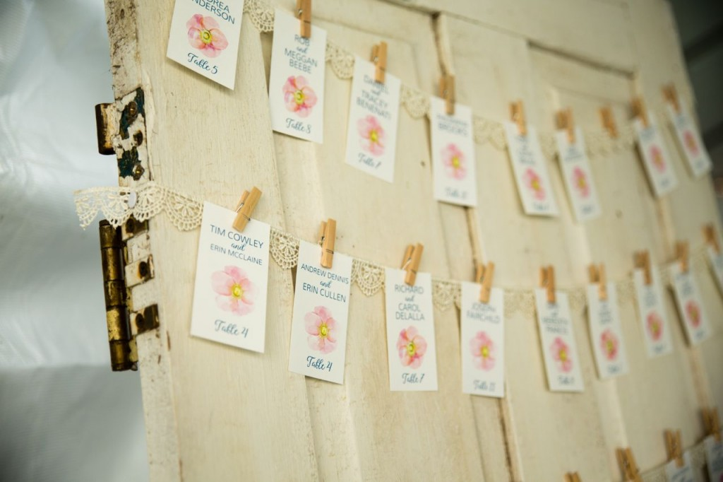 escort cards on an old door for a vintage wedding
