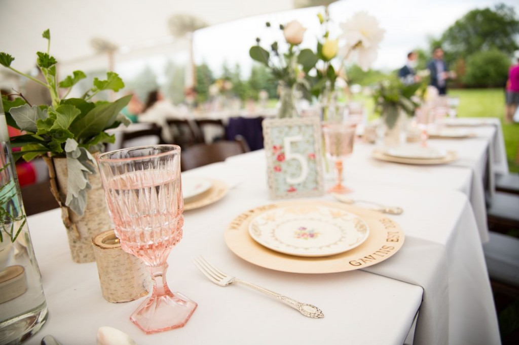 vintage wedding tableware with antique dishes, flatware and rose goblets.