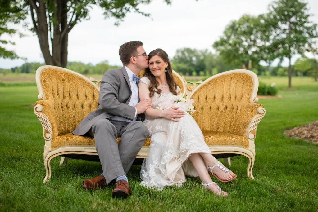 antique gold sofa at a vintage wedding