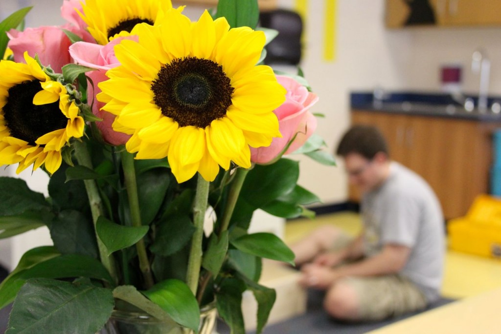 sunflowers and roses in the classroom