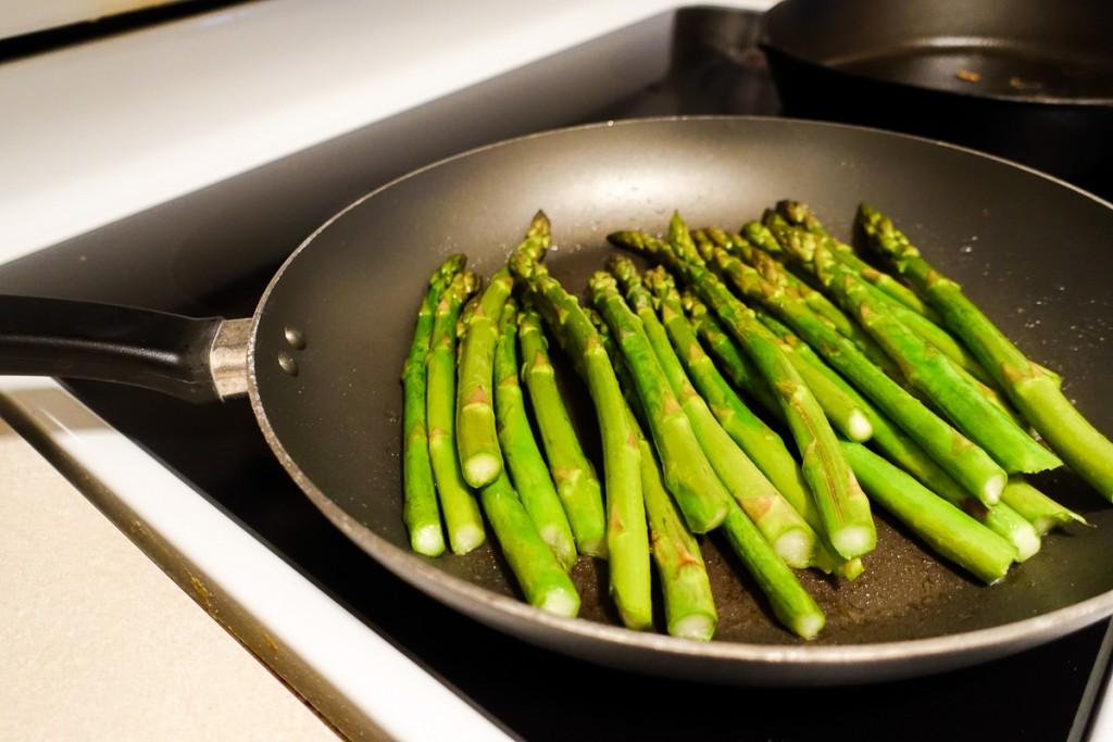 Fry asparagus on stove
