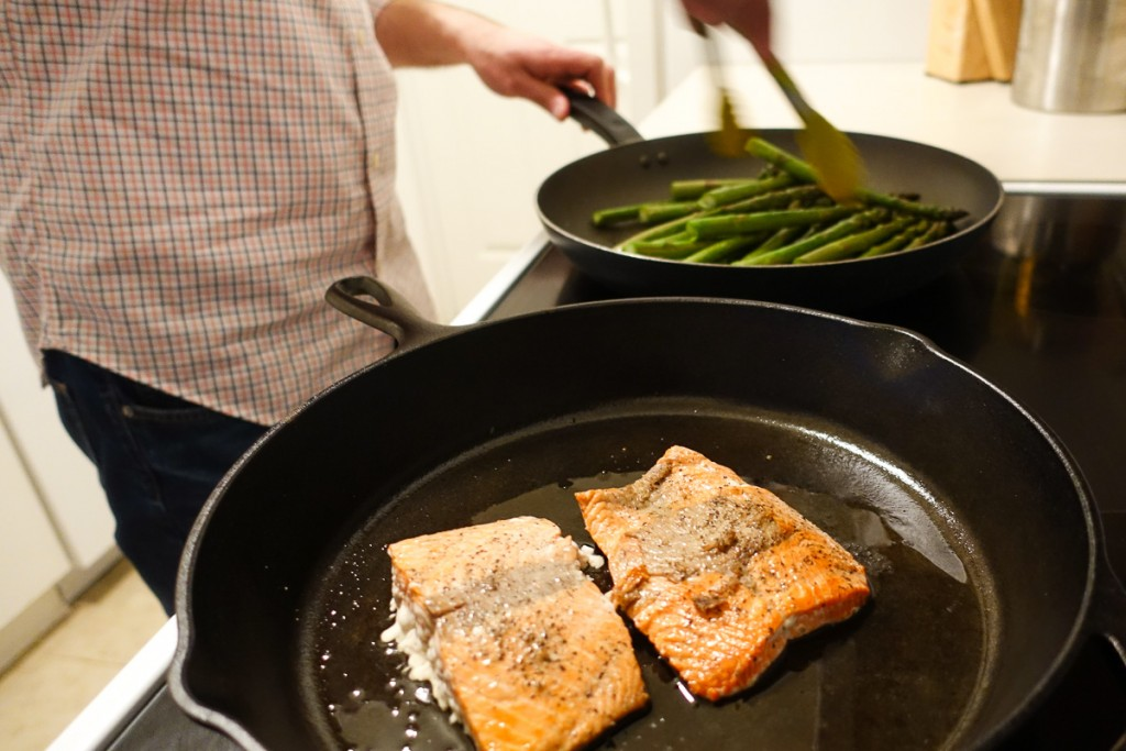 Cast iron salmon and asparagus on stove