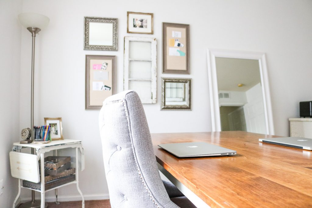 Work table, wall decor and mirror in vintage home office