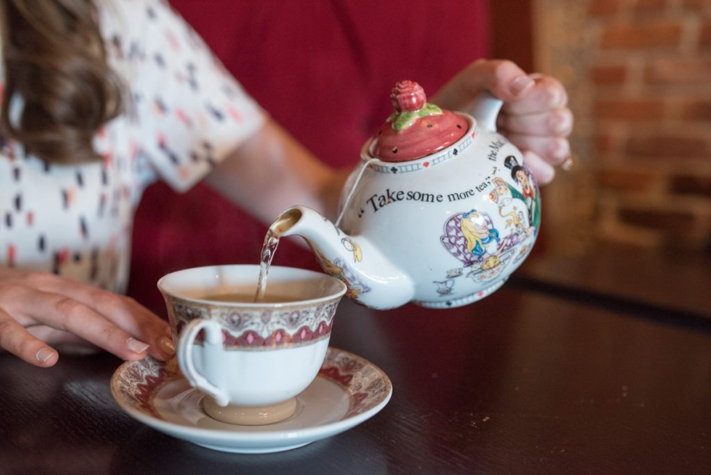 pouring tea at Mad Hatter Bistro in Birmingham, Michigan