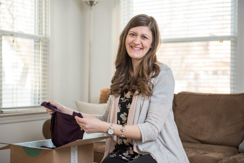 woman holding clothes from Stitch Fix box