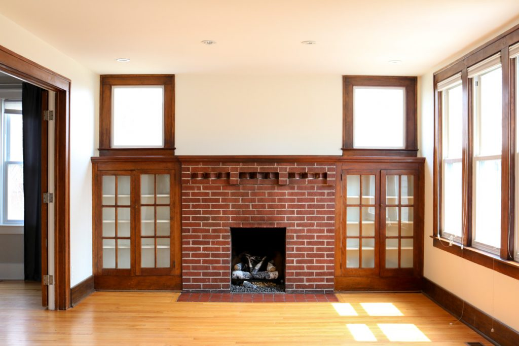 1925 home tour | living room with original fireplace and built in book cases | Crazy Together blog