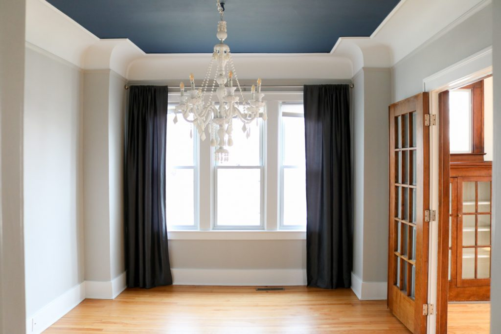 1925 home tour | dining room with white chandelier and navy blue ceiling | Crazy Together blog