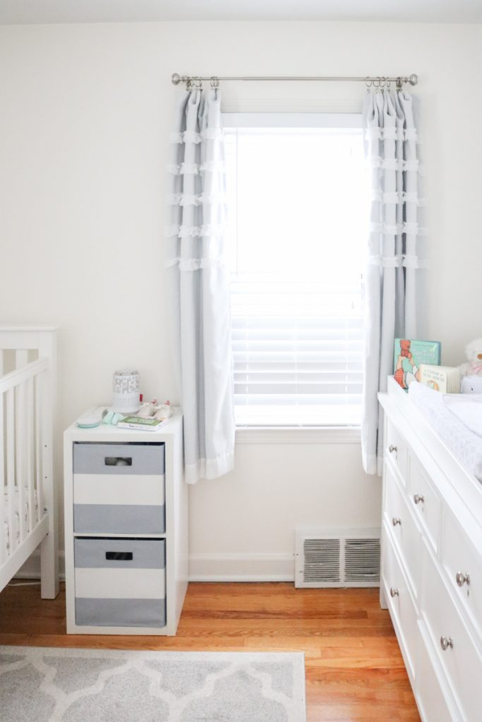 sweet and feminine ruffled baby nursery curtains in a light and airy baby nursery with a gray and white color scheme | tiny baby nursery | small baby nursery | gray and white nursery | neutral baby nursery decor | neutral palette nursery reveal | gender-neutral baby nursery | budget-friendly baby nursery | Crazy Together blog