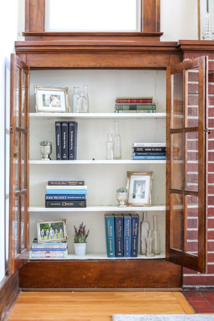 Simple, budget-friendly living room built-in bookcase styling | How I styled my 1925 craftsman house living room cabinets with objects I already owned | Crazy Together blog #homedecor #decor #farmhouse #farmhousedecor #craftsmanhouse