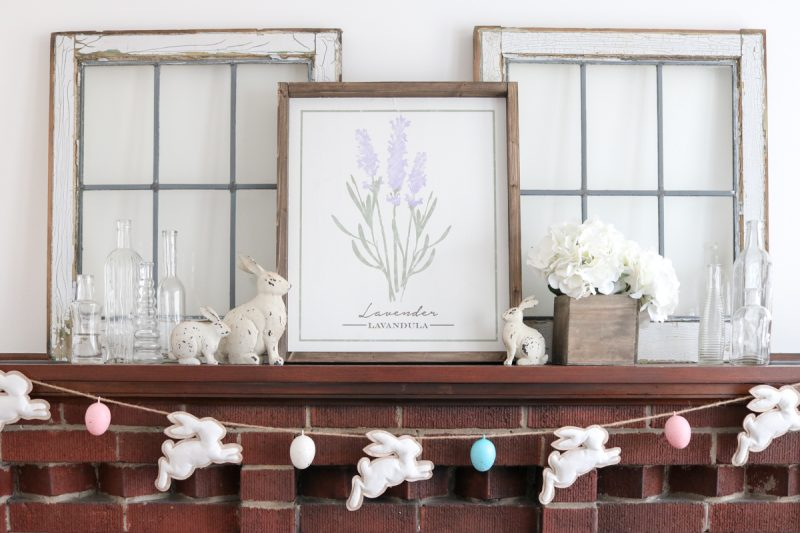 Take a peek into our home at Easter time our farmhouse-inspired mantle decor with a touch of rustic flair. I always love to extend any decor past a single holiday and removing the garland will help the mantle decor stay in season all spring long.