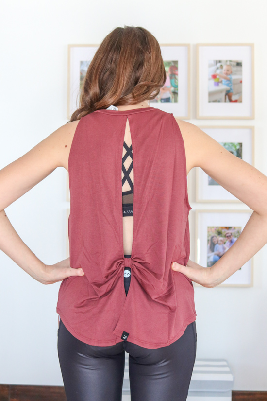back view of merlot tie-back workout tank with shiny black leggings from Wantable