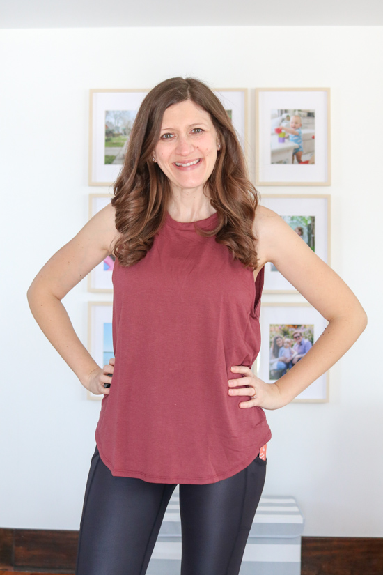 woman wearing merlot colored electric tank with shiny black leggings from Wantable