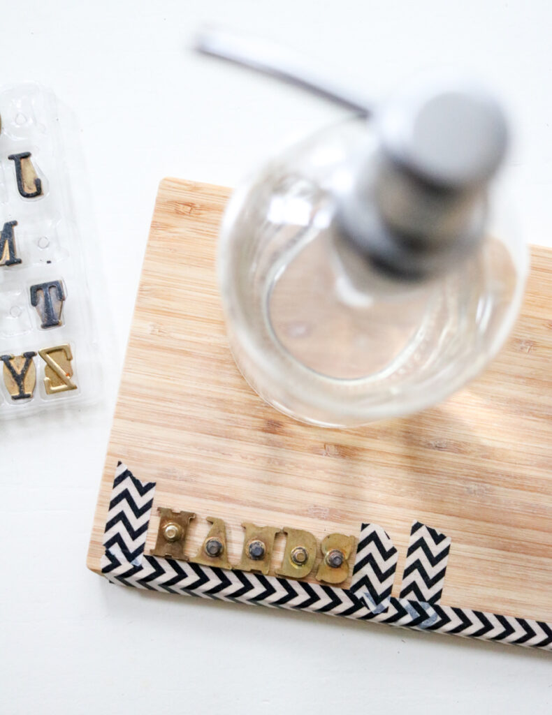 using washi tape as a spacing guide for HANDS label - DIY woodburned hand soap dispenser tray
