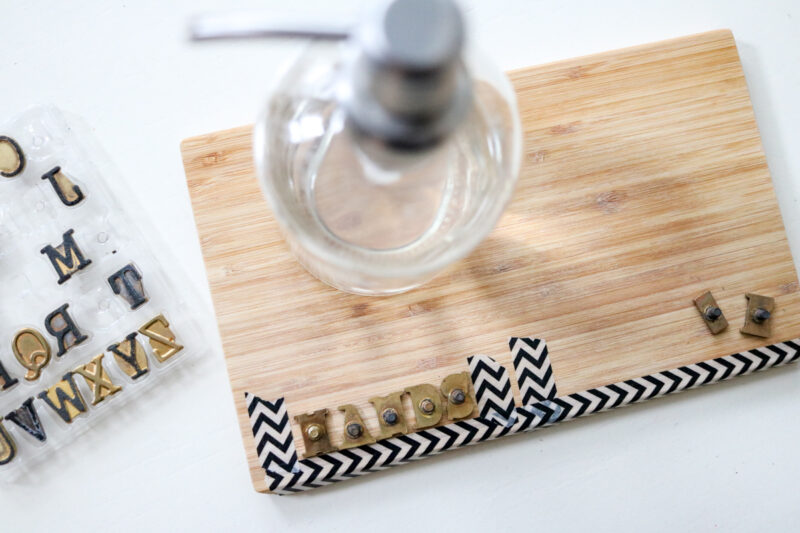 using washi tape as a spacing guide for DIY woodburned hand soap dispenser tray