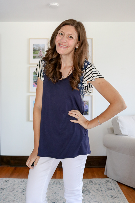 Fashion subscription box review of navy blue Sarina Top from Lovely Melody with white cropped jeans